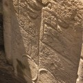 Detail of petroglyphs on back of RR-001-156 revealed through excavation. © EISP 2011