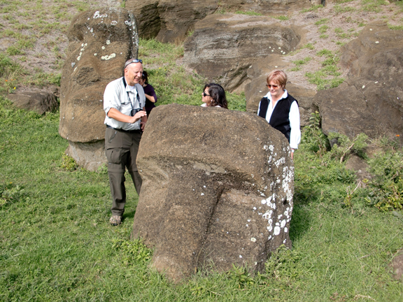 Christian Fischer, Mónica Bahamondez P. and Jo Anne Van Tilburg in the Rano Raraku quarry with statues 'Mama' and 'Papa.'