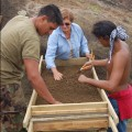 Jo Anne Van Tilburg, Benjamin Mihaore Pakarati González, and Carlos E. Rapu Rapu screening excavation deposits in Rano Raraku Quarry, 2010