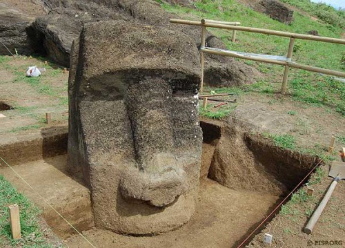 """March-April 2010: EISP's excavation of a <i>moai</i> in Rano Raraku Quarry interior. This moai was nicknamed """"Papa"""" by Katherine Routledge in 1914. Quarry bedrock is visible in one of the excavation squares. The color variation on the statue's stone surface reflects previous soil levels."""