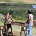 Patricio Rodrigo Madariaga Paoa and Benjamin Mihaore Pakarati González screening excavation deposits.