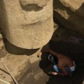 Cleaning petroglyph on front of torso. © EISP.ORG 2013