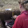 Dr. Sarah Sherwood collecting soil samples, Square 24. © EISP.ORG 2014