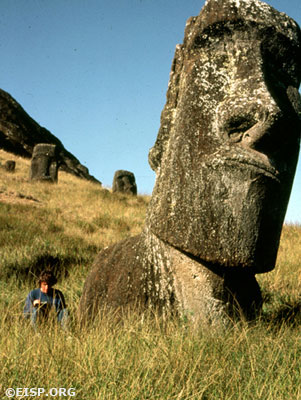 Johannes Van Tilburg sketching in the shadow of Moai RR-002-089 of Exterior Rano Raraku Quarry.