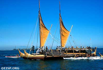 Polynesian Voyaging Society's Hokule'a in Long Beach Harbor, escorted by Rapa Nui paddlers. ©1995/RNOC/Photo: Jo Anne Van Tilburg.