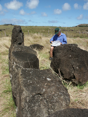 A view of the <em>moai</em> from the top of its head in the foreground, with Johannes Van Tilburg sketching in the background. ©2002 EISP/JVT/Photo: Alice Hom.