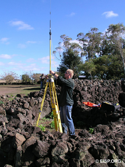 Matthew Bates sets up the base station for surveying Rano Raraku. Photo: A. Hom