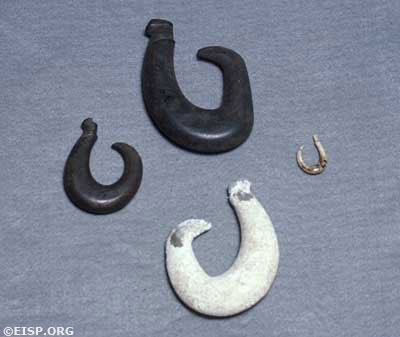 Rapa Nui fishhooks (mangaia), including one of basalt (top) and one of human bone. Photo by: David C. Ochnser. Copyright Jo Anne Van Tlburg/EISP. Courtesy Museo Antropologico Padre Sebastian Englert (MAPSE), Rapa Nui (Easter Island).