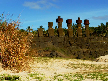 Restored moai with taheta at Anakena, north coast, Rapa Nui. © EISP 2003.