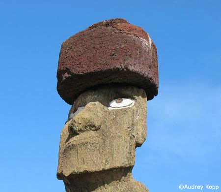<em>Moai</em> with a <em>pukao</em>, and replica inset eyes at Ahu Tahai. Photo by Audrey Kopp.