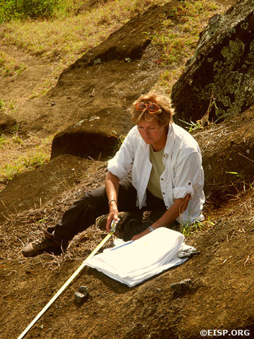 Jo Anne Van Tilburg taking measurements at Rano Raraku Interior Quarry. ©2003 EISP/JVT/Photo: Alana Perlin.