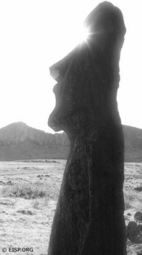 Empty eyesockets of a bearded moai standing near Ahu Tongariki are magically filled with sunbeams.  Photo by David C. Ochnser, copyright EISP, 1989.