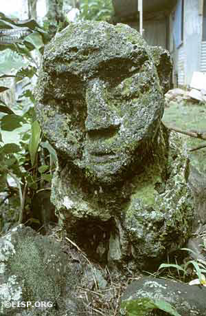 Monolith number 01 (total height, 85.4 cm) at Ngerbodel is the only figure (type D) documented in Belau that unambiguously consists of head and torso carved out of one piece of stone. Photo by David C. Ochsner, ©1987 Jo Anne Van Tilburg.