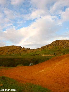 View from the volcanic crater Rano Raraku as a faint rainbow appears in the sky above. © EISP 2003.