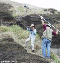 EISP field crew members Debra Isaac and Bill White use a boom to capture digital overheads of Moai RR-03C-011, Rano Raraku Interior Quarry, 2002. Photo by Gordon Hull.