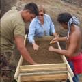 Jo Anne Van Tilburg, Benjamin Mihaore Pakarati González, and Carlos E. Rapu Rapu screening excavation deposits in Rano Raraku Quarry, 2010
