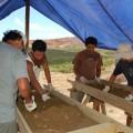 Cristián Arévalo Pakarati, Rafael Paoa Rapu, Isaias Hey Gonzalez, and Joaquin Soler Hotu screening recovered deposits.